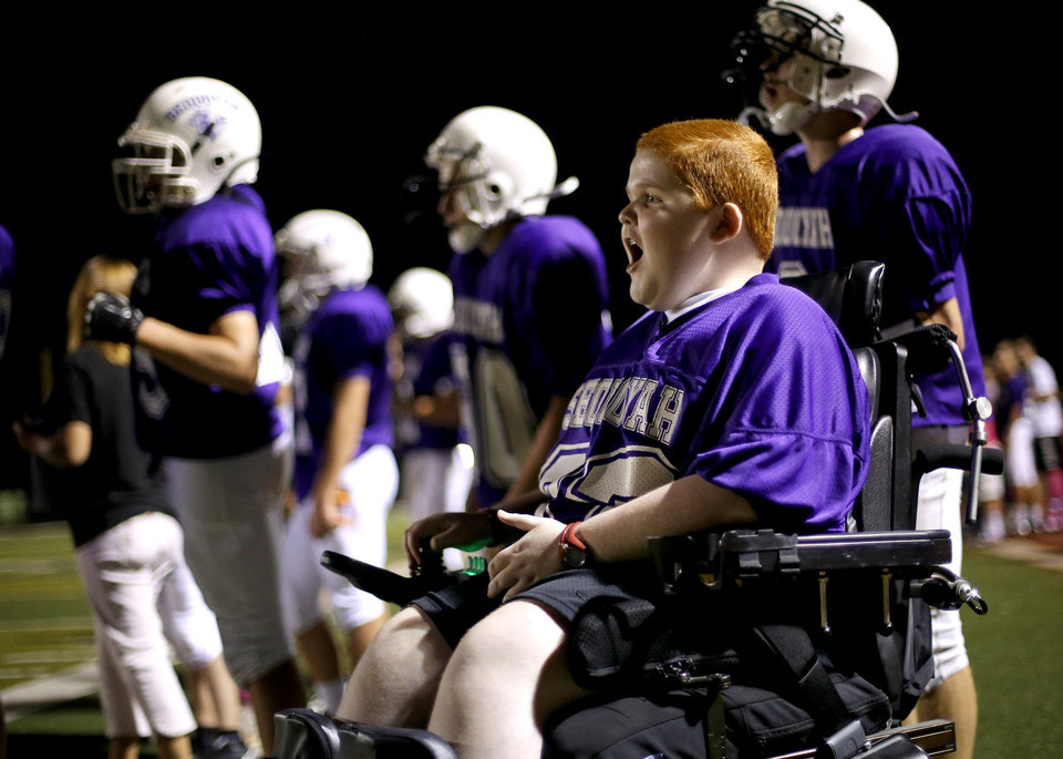 Photo - Keegan Erbst watches from sidelines during a Sequoyah Middle School football game, Thursday, September 27, 2012. Keegan, who has muscular dystrophy and is confined to a wheelchair, got involved with the team after players Lucas Coker, Colton James, and Parker Tumleson, pushed suggested it to the coach.  Photo by Bryan Terry, The Oklahoman
