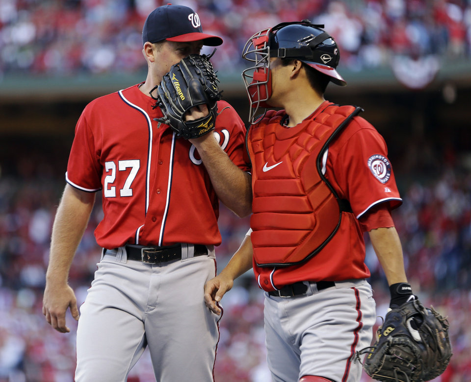 Photo -   Washington Nationals starting pitcher Jordan Zimmermann, left, talks with catcher Kurt Suzuki as they walk off the field at the end of the second inning in Game 2 of baseball's National League division series against the St. Louis Cardinals, Monday, Oct. 8, 2012, in St. Louis. (AP Photo/Jeff Roberson)