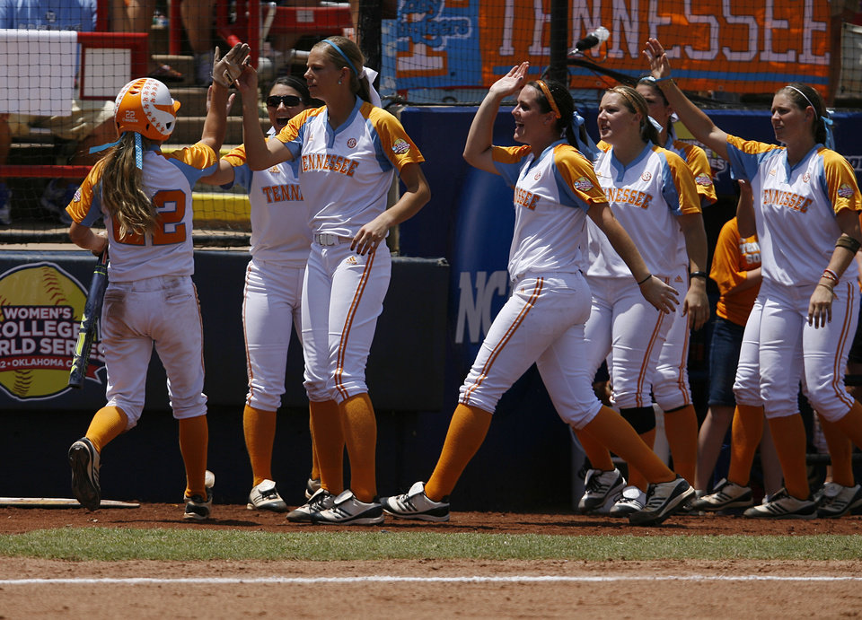 Tennessee's Ashley Andrew's (22) celebrates with her teammates during a Women's College World Series game between Tennessee and Oregon at ASA Hall of Fame Stadium in Oklahoma City, Saturday, June 2, 2012.  Photo by Garett Fisbeck, The Oklahoman