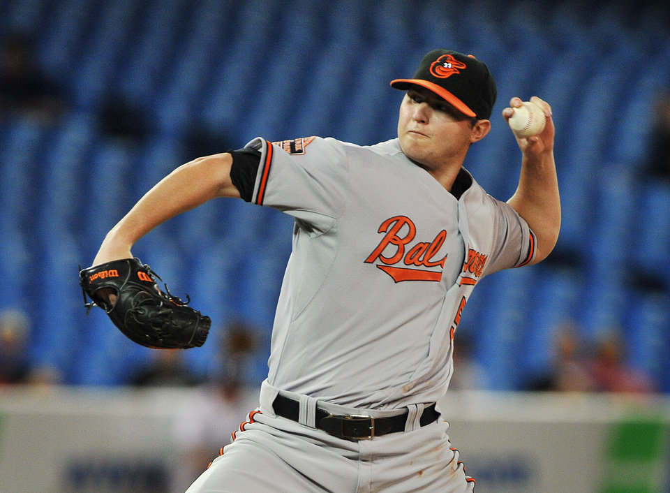 Photo -   Baltimore Orioles pitcher Zach Britton works against the Toronto Blue Jays during the first inning of their baseball game in Toronto, Tuesday, Sept. 4, 2012. (AP Photo/The Canadian Press, Aaron Vincent Elkaim)
