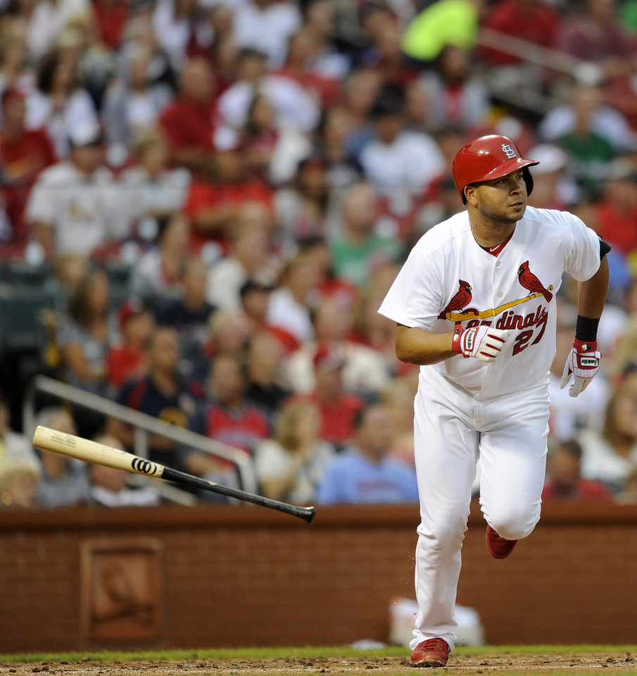 Photo - St. Louis Cardinals' Jhonny Peralta (27) watches his two-run double against the Boston Red Sox in the first inning in a baseball game, Thursday, August 7, 2014, at Busch Stadium in St. Louis. (AP Photo/Bill Boyce)
