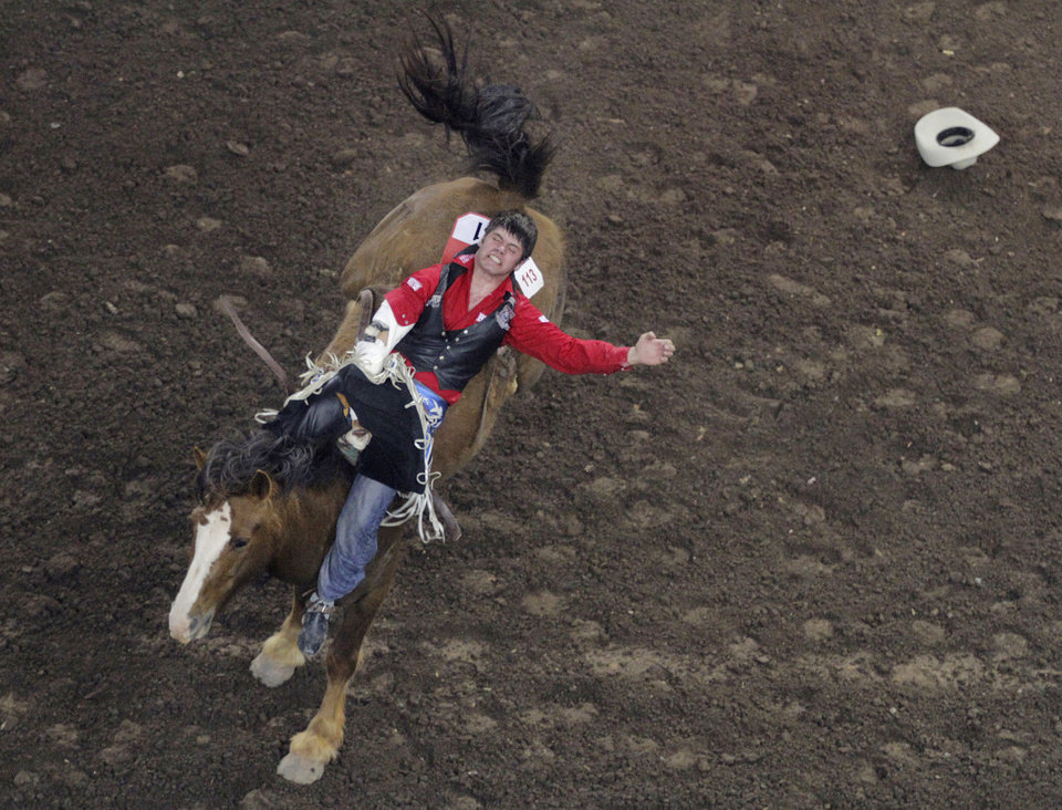 Luke Creasy, of Brownfield, Alberta, competes in bareback riding during the Ram National Circuit Finals Rodeo Championship in Oklahoma City, Sunday, April 1, 2012.  Photo by Garett Fisbeck, For The Oklahoman