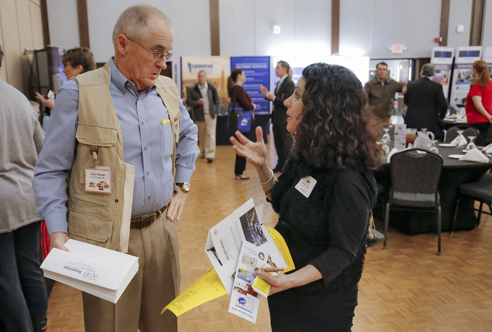 Photo -  Jack Werner of A to Z Inspections talks with with Theresa Nicoletto of JBT Property Solutions during the Commercial Real Estate Summit in the Nigh University Center at the University of Central Oklahoma on Thursday. [PHOTO BY CHRIS LANDSBERGER, THE OKLAHOMAN]