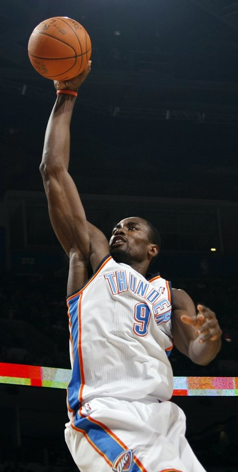 Photo - Oklahoma City's Serge Ibaka (9) goes up for a dunk during the NBA basketball game between the Minnesota Timberwolves and the Oklahoma City Thunder at the Oklahoma City Arena, Monday, November 22, 2010, in Oklahoma City. Photo by Nate Billings, The Oklahoman
