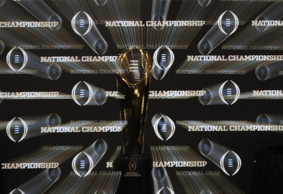 Photo - The championship trophy is seen before a news conference for the NCAA college football playoff championship game between Alabama and Clemson Sunday, Jan. 6, 2019, in Santa Clara, Calif. (AP Photo/David J. Phillip)