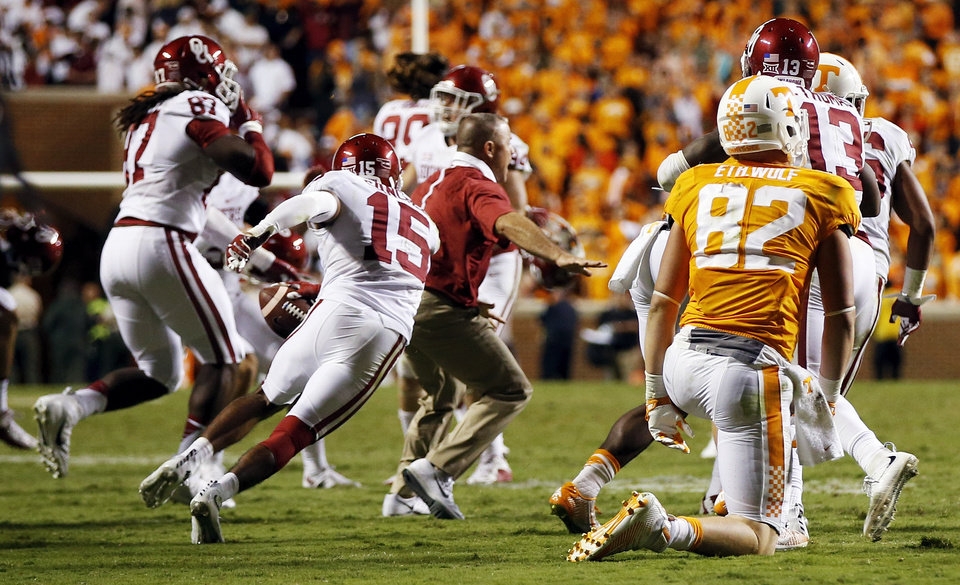 Photo - The Sooners celebrate after an interception by Zack Sanchez (15) of a pass intended for Tennessee's Marquez North (not pictured) to end the game in double overtime during a college football game between the Oklahoma Sooners (OU) and the Tennessee Volunteers at Neyland Stadium in Knoxville, Tennessee, Saturday, Sept. 12, 2015. OU won 31-24 in double overtime. Photo by Nate Billings, The Oklahoman