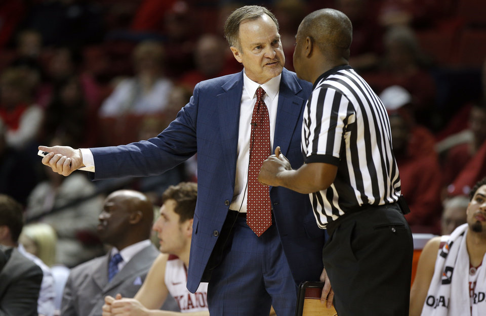 Photo - Oklahoma coach Lon Kruger argues after a call with an official during an NCAA college basketball game between the University of Oklahoma and Texas Tech University at the Lloyd Noble Center in Norman, Okla., Wednesday, Feb. 12, 2014. Oklahoma lost 68-60. Photo by Bryan Terry, The Oklahoman