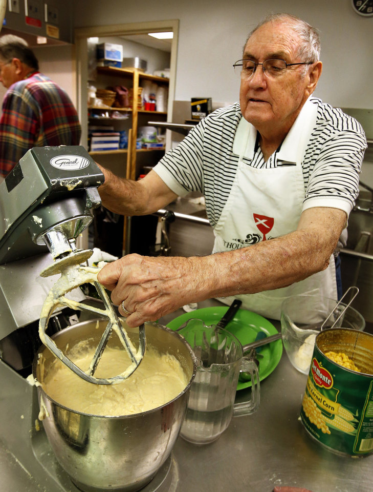 Jim Burleson mixes cornbread batter Tuesday at the annual Benefit Bean Dinner at Norman's First Christian Church that raises money for Health for Friends' medication fund. PHOTO BY STEVE SISNEY, THE OKLAHOMAN <strong>STEVE SISNEY</strong>