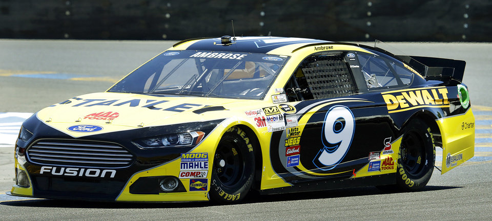 Photo - Marcos Ambrose, of Australia, races during qualifying laps for the NASCAR Sprint Cup Series auto race on Saturday, June 22, 2013, in Sonoma, Calif. (AP Photo/Ben Margot)