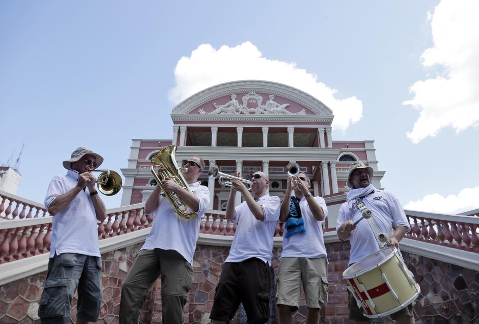 Photo - Members of the England Band from Sheffield, England, play in front of the Manaus Opera House during the 2014 soccer World Cup in Manaus, Brazil, Friday, June 13, 2014. Band members claim they have played in venues hosting England for the past 5 World Cups. This year, they will not be allowed to bring their instruments into the stadiums. England faces Italy in Manaus on June 14th.  (AP Photo/Marcio Jose Sanchez)