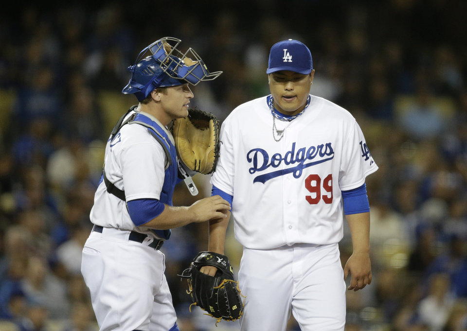 Photo - Los Angeles Dodgers catcher Tim Federowicz, left, talks to starting pitcher Hyun-Jin Ryu, of South Korea, during the fifth inning of a baseball game against the Philadelphia Phillies on Tuesday, April 22, 2014, in Los Angeles. (AP Photo/Jae C. Hong)
