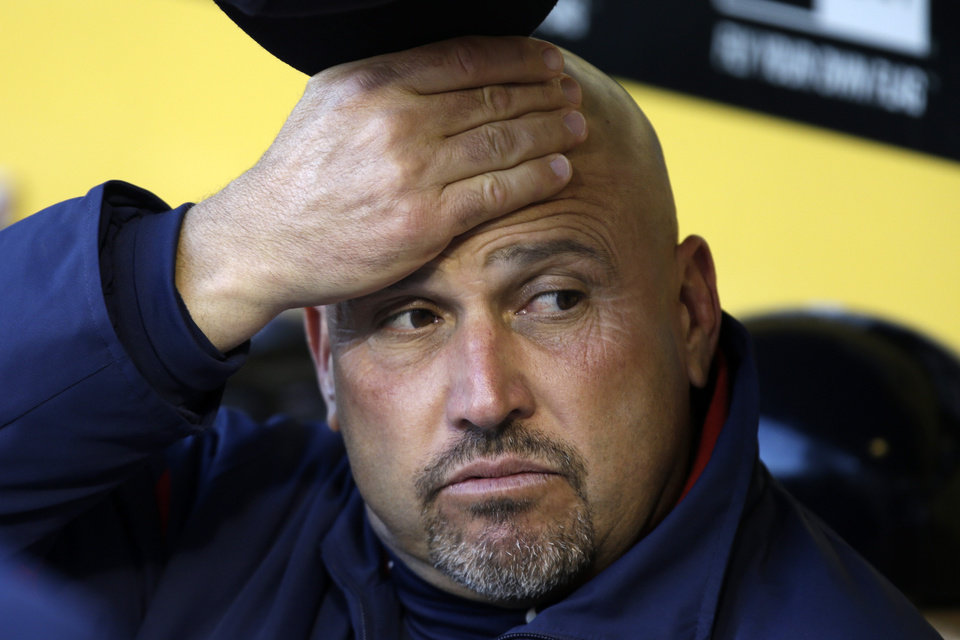 Atlanta Braves manager Fredi Gonzalez sits in the dugout before of a baseball game against the Pittsburgh Pirates in Pittsburgh, Saturday, April 20, 2013. The Pirates won 3-1. (AP Photo/Gene J. Puskar)