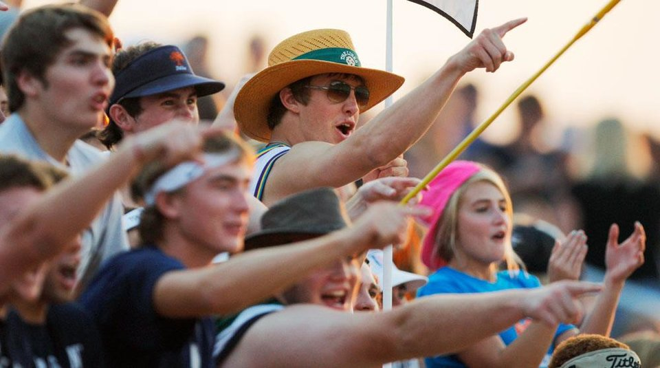 Photo -  Edmond North fans cheer during a high school football game between Edmond North and Southmoore in Moore, Okla., Thursday, Sept. 1, 2011. Photo by Nate Billings, The Oklahoman
