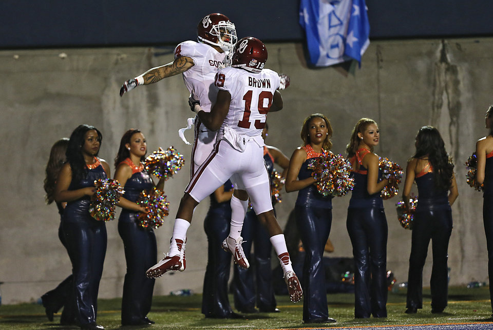 Photo - Oklahoma Sooners wide receiver Kenny Stills (4) and Oklahoma Sooners wide receiver Justin Brown (19) react after Stills' touchdown during the college football game between the University of Oklahoma Sooners (OU) and the University of Texas El Paso Miners (UTEP) at Sun Bowl Stadium on Saturday, Sept. 1, 2012, in El Paso, Tex.  Photo by Chris Landsberger, The Oklahoman