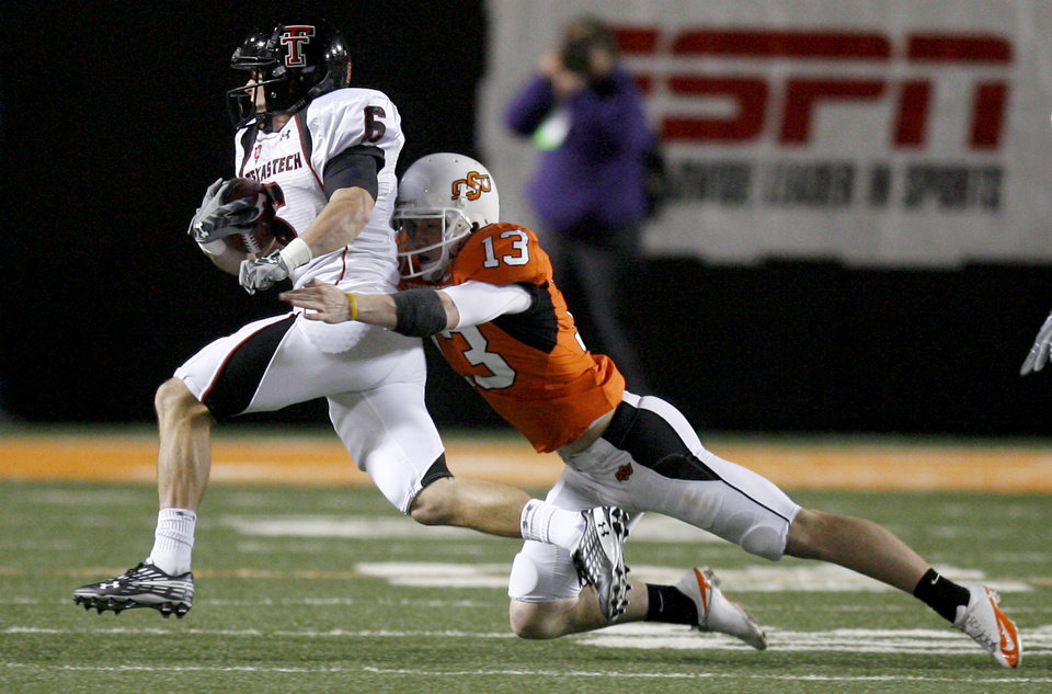 Photo - OSU kicker Quinn Sharp (13) tackles Texas Tech's Austin Zouzalik (6) during the college football game between Oklahoma State University (OSU) and Texas Tech University at Boone Pickens Stadium in Stillwater, Okla. Saturday, Nov. 14, 2009. Photo by Sarah Phipps, The Oklahoman