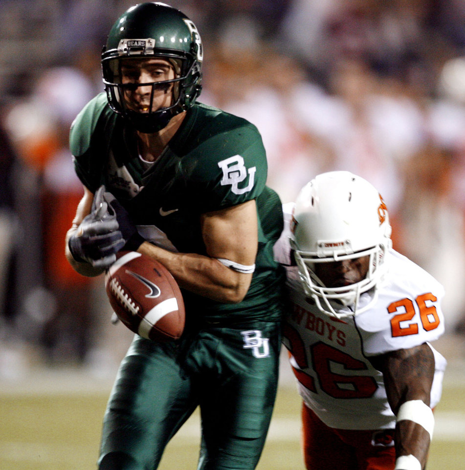 Quinton Moore (26) breaks up a pass to Thomas White during first half action in the college football game between Oklahoma State University and Baylor University at Floyd Casey Stadium in Waco, Texas, Saturday, Nov. 17, 2007. BY STEVE SISNEY, THE OKLAHOMAN