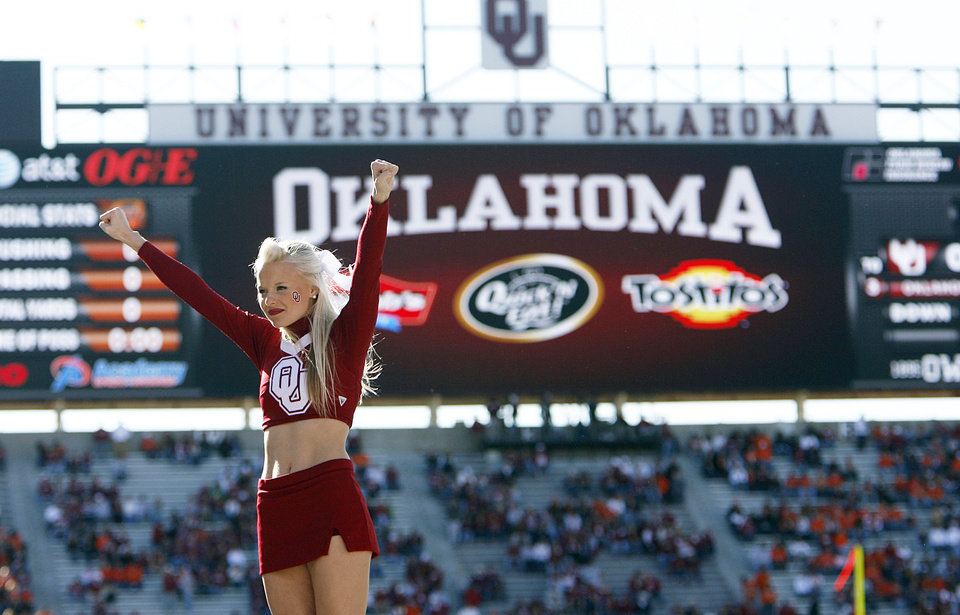 Photo - A member of the Oklahoma cheer team performs before the Bedlam college football game between the University of Oklahoma Sooners (OU) and the Oklahoma State University Cowboys (OSU) at the Gaylord Family-Oklahoma Memorial Stadium on Saturday, Nov. 28, 2009, in Norman, Okla.Photo by Chris Landsberger, The Oklahoman