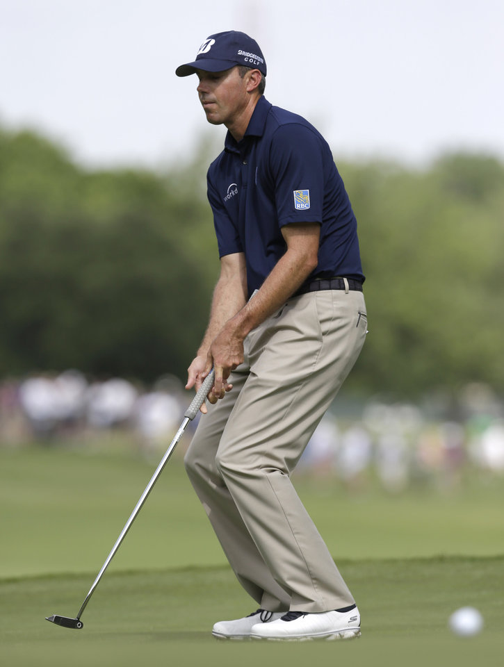 Photo - Matt Kuchar reacts to missing a putt on the first hole during the first round of the PGA Colonial golf tournament n Fort Worth, Texas, Thursday, May 22, 2014.   (AP Photo/LM Otero)