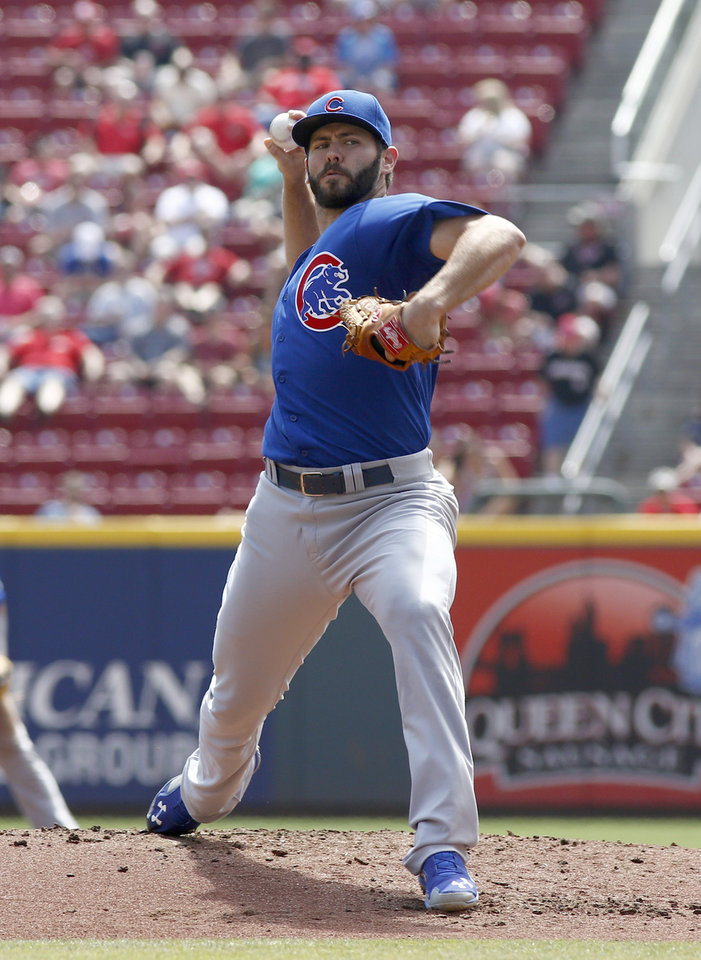 Photo - Chicago Cubs starting pitcher Jake Arrieta throws against the Cincinnati Reds in the first inning of a baseball game, Thursday, Aug. 28, 2014, in Cincinnati. (AP Photo/David Kohl)