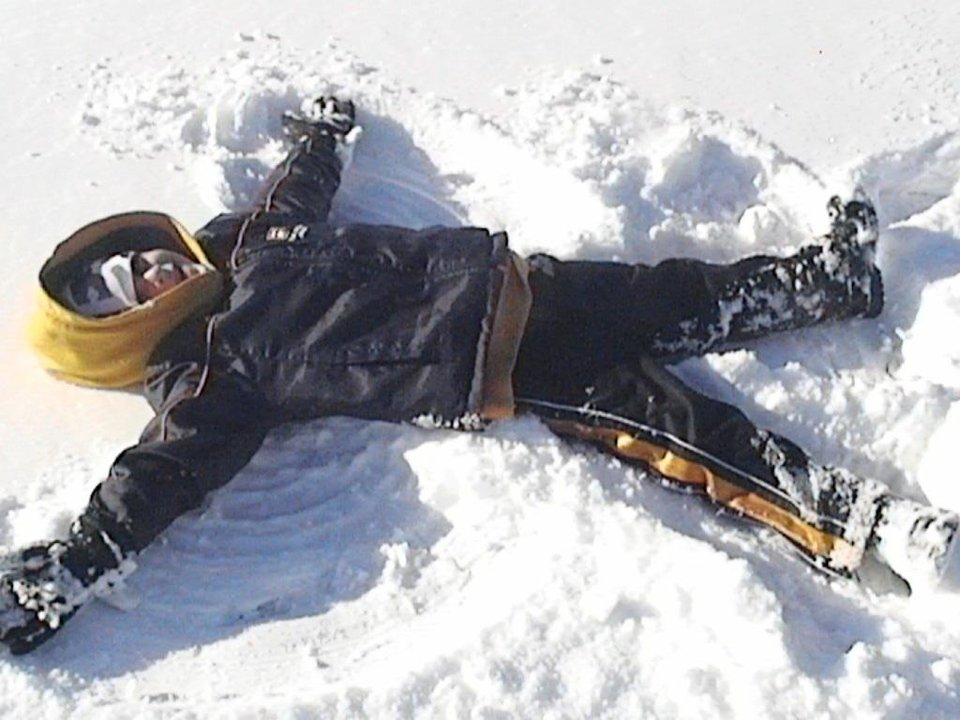 Jayce having fun making a snow angel!<br/><b>Community Photo By:</b> Richelle McIver<br/><b>Submitted By:</b> richelle, Midwest City