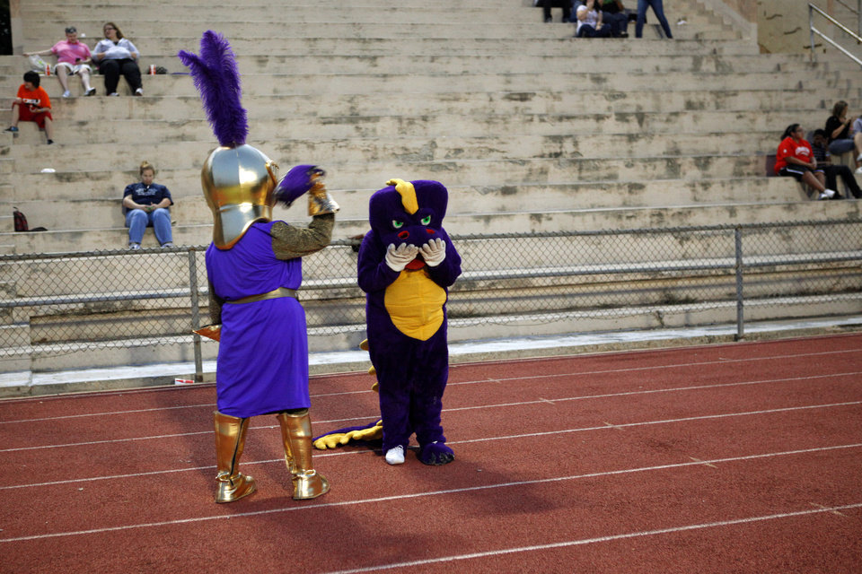 Photo - The Northwest Classen mascots joke around during a high school football game at Taft Stadium in Oklahoma City, Thursday, September 20, 2012. Photo by Bryan Terry, The Oklahoman