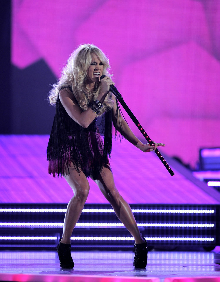 Carrie Underwood performs at the 47th Annual Academy of Country Music Awards on Sunday, April 1, 2012 in Las Vegas. (AP Photo/Mark J. Terrill)
