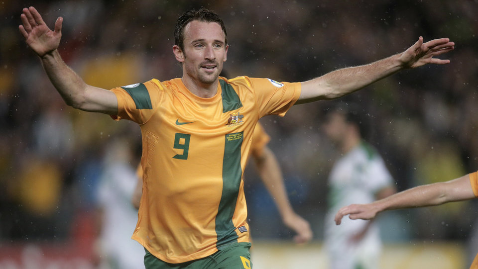 Australia's Josh Kennedy celebrates after scoring against Iraq during their World Cup soccer Asian qualifying match at the Sydney Olympic Stadium in Sydney, Australia, Tuesday, June 18, 2013. Australia won the match 1-0 and qualify for the 2014 World Cup in Brazil. (AP Photo/Rick Rycroft)