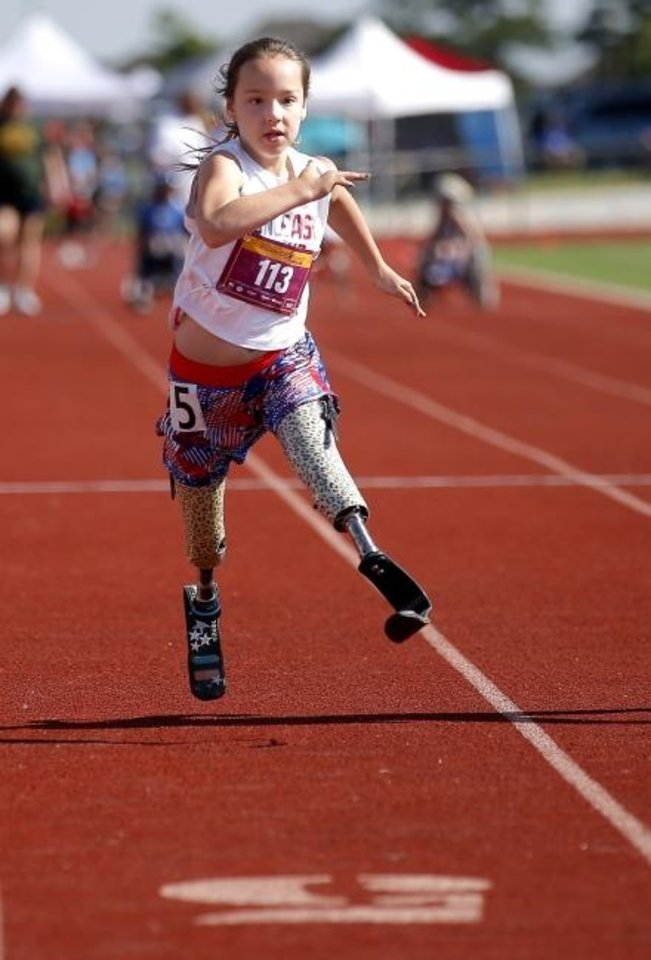 Photo -  Ellie Todd competes in the 100-meter dash Saturday during the during the Endeavor Games at Edmond North High School. [Sarah Phipps/The Oklahoman]