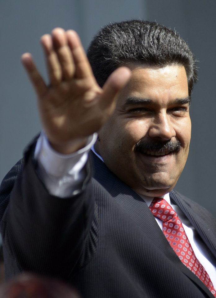 Photo - Venezuela's President Nicolas Maduro waves as he arrives at the presidential residencein Montevideo, Uruguay, Tuesday, May 7, 2013. Maduro is on a one-day official visit to Uruguay. (AP Photo/Matilde Campodonico)