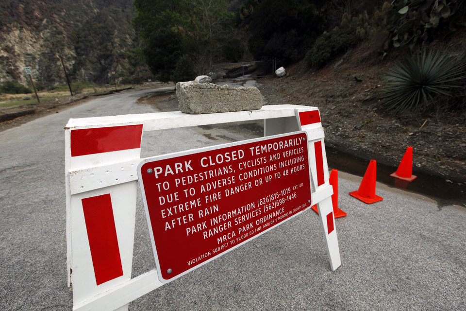 Photo - River Wilderness Park in San Gabriel Canyon is temporarily closed, one of several areas considered especially at risk in Azusa, Calif., as the city prepares for possible flooding Thursday, Feb. 27, 2014. Mandatory evacuation orders have been issued for 1,000 homes in two foothill suburbs east of Los Angeles in advance of a powerful storm. The cities of Glendora and Azusa issued the orders at midday Thursday for homes that could be endangered by debris flows from nearly 2,000 acres (810 hectares) of steep mountain slopes burned by a wildfire last month. For days, both cities have been making extensive preparations including sandbagging. California received widespread rain Wednesday and early Thursday from the first of two back-to-back storms. The more powerful second storm is due overnight.  (AP Photo/Reed Saxon)