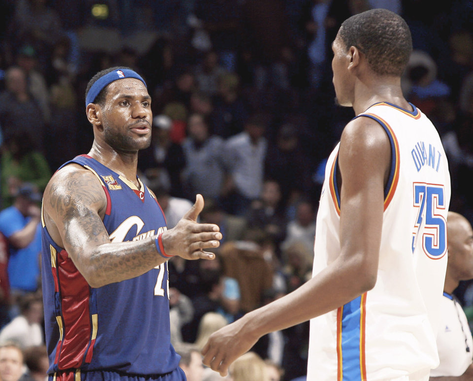 Photo - Cleveland's LeBron James, left, meets the Thunder's Kevin Durant on Sunday.  Photo by Sarah Phipps, The Oklahoman