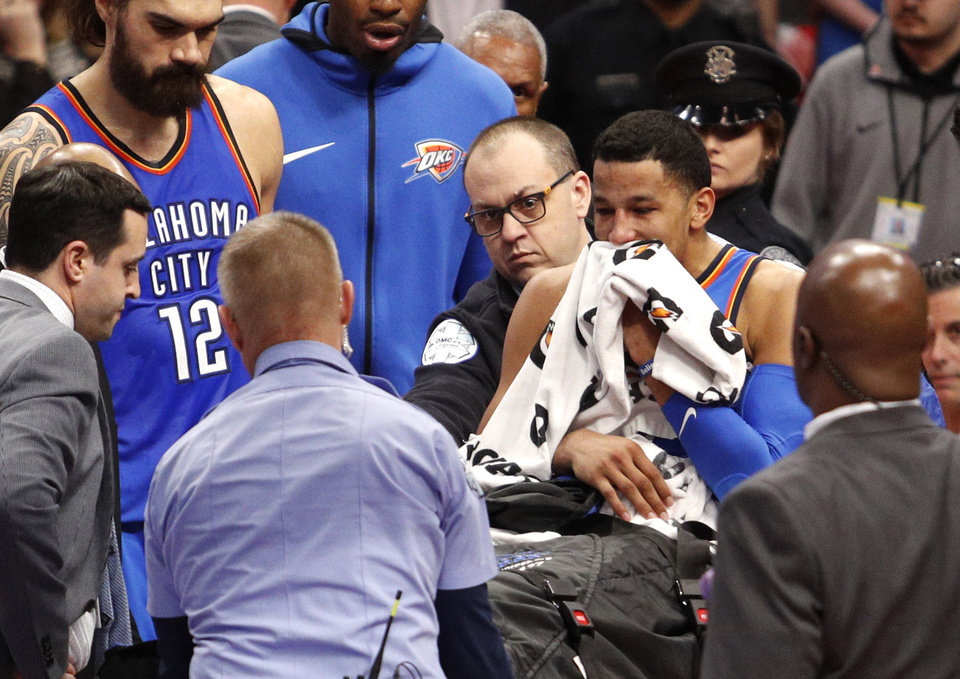 Photo - Jan 27, 2018; Detroit, MI, USA; Oklahoma City Thunder guard Andre Roberson (towel) sits on a stretcher after a bad slip and fall injury during the third quarter against the Detroit Pistons at Little Caesars Arena. Mandatory Credit: Raj Mehta-USA TODAY Sports