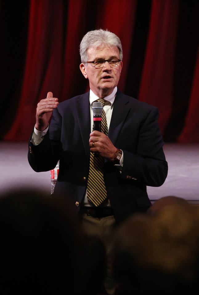 Photo - Sen. Tom Coburn speaks during his final town hall meeting at Tulsa Community College's VanTrease Performing Arts Center in Tulsa, Okla. on Wednesday, August 13, 2014. MATT BARNARD/Tulsa World