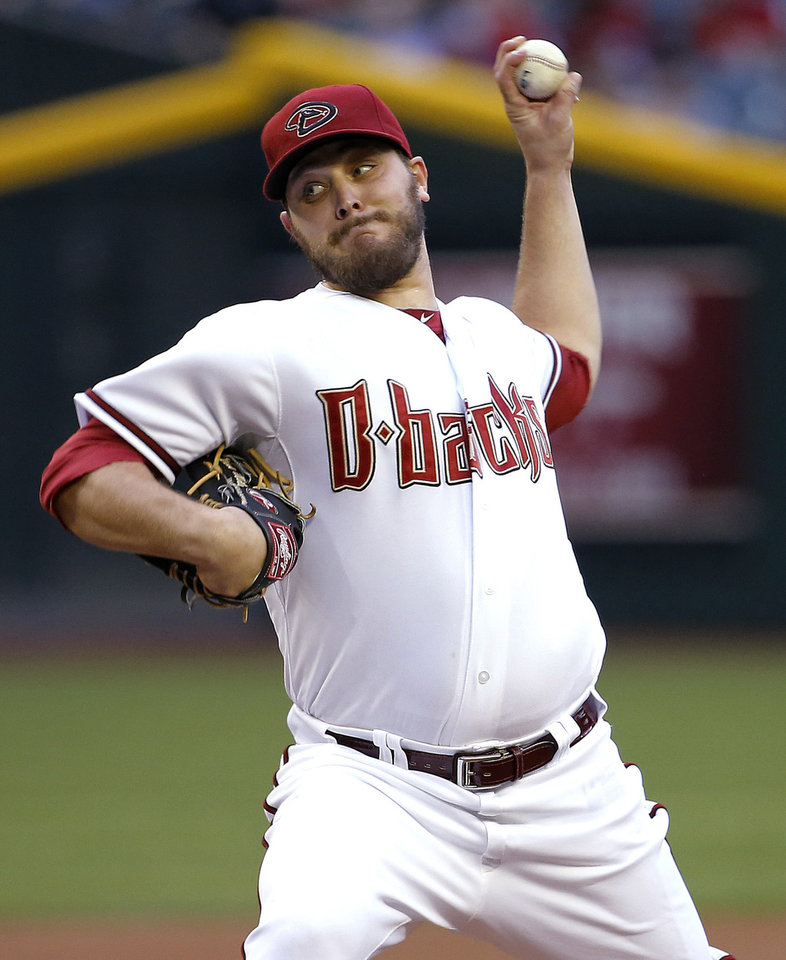 Photo - Arizona Diamondbacks pitcher Wade Miley throws during the first inning of a baseball game against the San Diego Padres, Tuesday, May 27, 2014, in Phoenix. (AP Photo/Matt York)