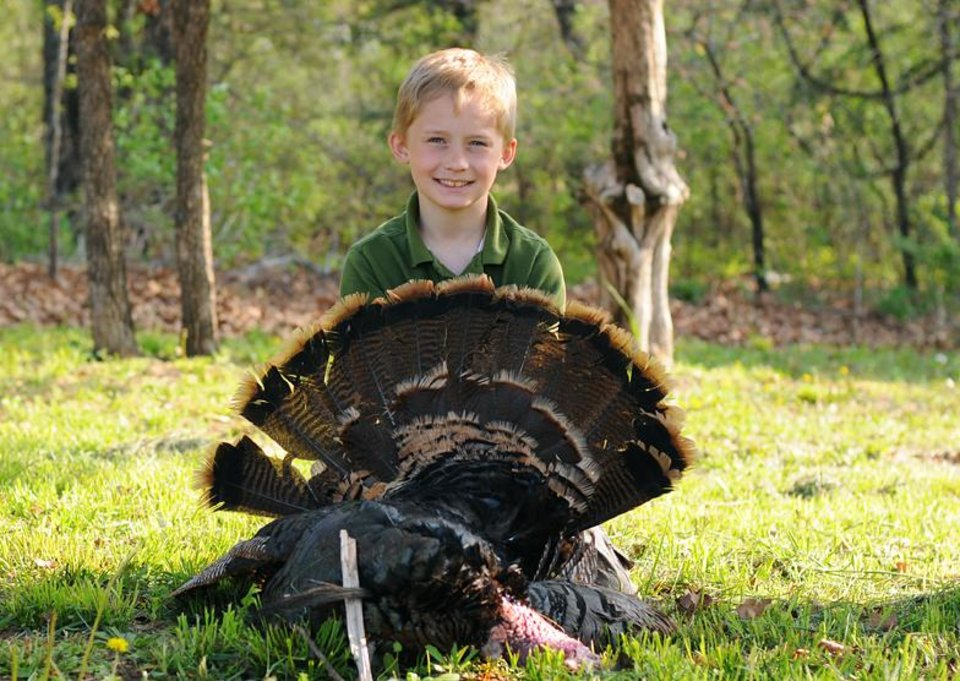 Photo - Dawson Sallee, 8, of Guthrie killed his first gobbler during last weekend's youth turkey season. PHOTO PROVIDED