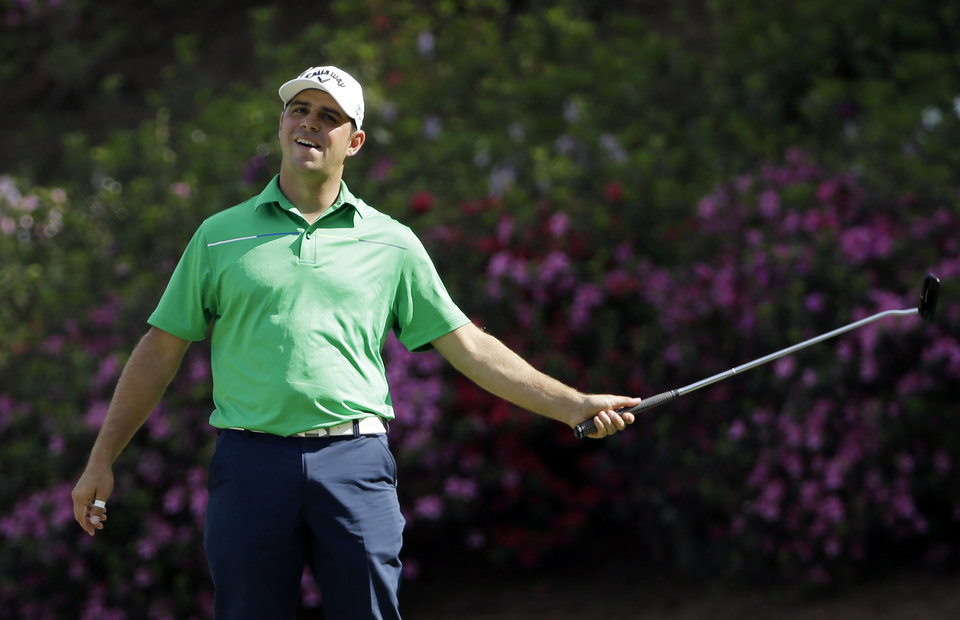 Photo - Gary Woodland reacts after missing an eagle on the 13th hole during the second round of the Masters golf tournament Friday, April 11, 2014, in Augusta, Ga. (AP Photo/David J. Phillip)