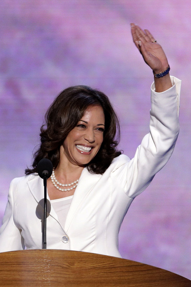 Photo - California Attorney General Kamala D. Harris waves before addressing the Democratic National Convention in Charlotte, N.C., on Wednesday, Sept. 5, 2012. (AP Photo/J. Scott Applewhite)  ORG XMIT: DNC158
