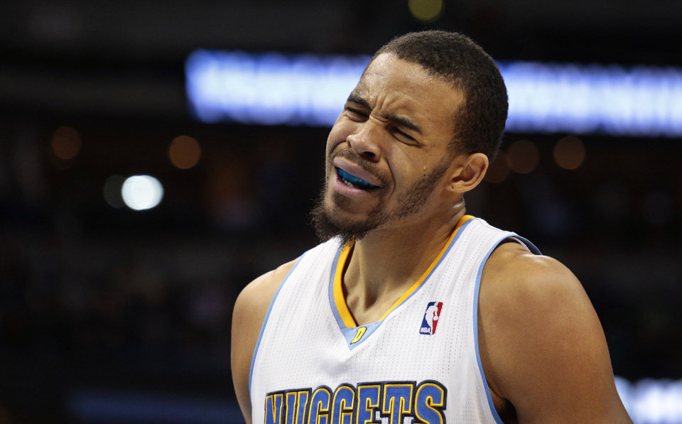 Photo - Denver Nuggets' Javale McGee reacts to committing a foul against the San Antonio Spurs in the first quarter of a basketball game in Denver on Tuesday, Nov. 5, 2013. San Antonio won 102-94. (AP Photo/Joe Mahoney)