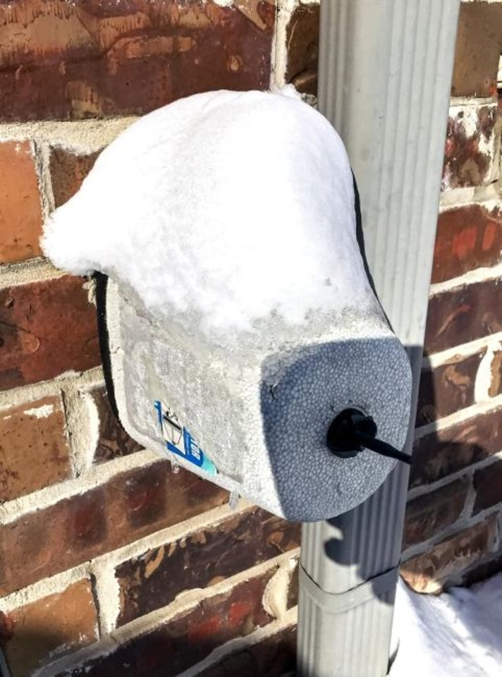 Photo -  A foam faucet cover protects an outdoor water faucet on a home in Oklahoma City, Okla. on Monday, Feb. 15, 2021.  [Chris Landsberger/The Oklahoman]