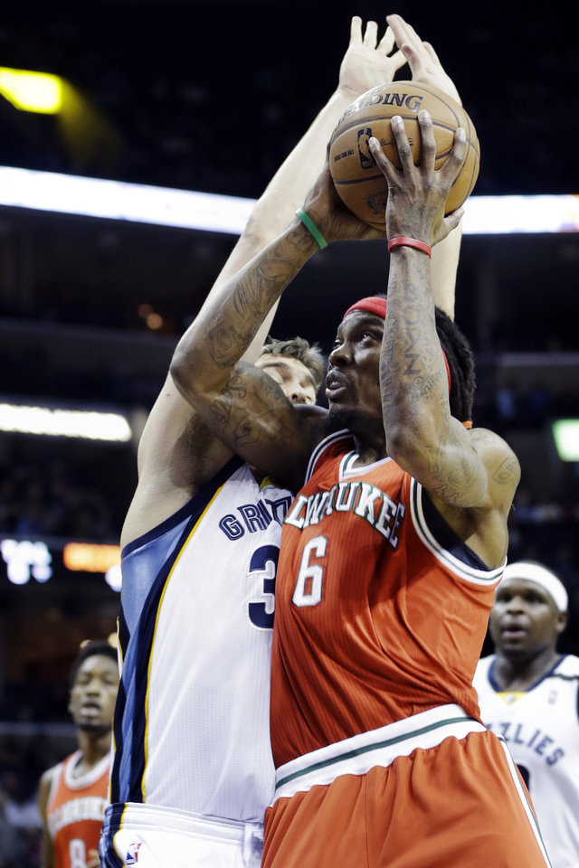 Photo - Milwaukee Bucks' Marquis Daniels (6) goes to the basket as he is pressured by Memphis Grizzlies' Marc Gasol, left, of Spain, during the first half of an NBA basketball game in Memphis, Tenn., Wednesday, Dec. 19, 2012. (AP Photo/Danny Johnston)