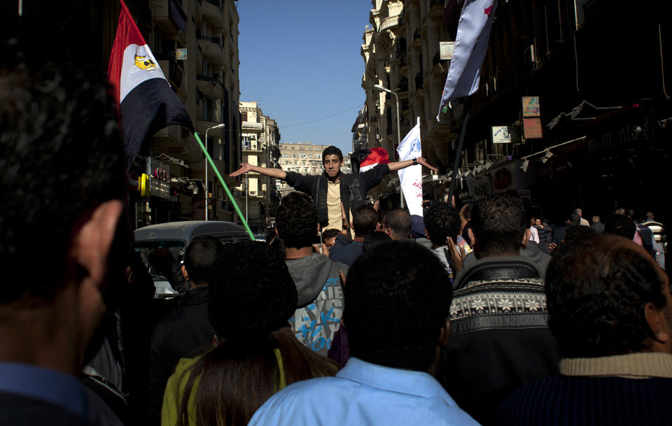 Egyptian protesters chant slogans denouncing the proposed constitution and the upcoming referendum during a rally in Cairo, Egypt, Thursday, Dec. 13, 2012. Egyptian President Mohammed Morsi�s Muslim Brotherhood and other Islamists have been plastering posters across much of the country urging Egyptians to vote �yes� and listing what they call the advantages of the new charter. �Yes, to protecting (Islamic) Sharia (laws),� says a Brotherhood website. The Islamists have also been using mosques to disseminate the �yes� message and putting to use their appeal to uneducated Egyptians in rural areas. But the pros and cons of the draft constitution and the question of whether it will be passed have grown more akin to being a secondary narrative to the worst crisis to hit Egypt since the overthrow nearly two years ago of Hosni Mubarak�s authoritarian regime. (AP Photo/Nasser Nasser)