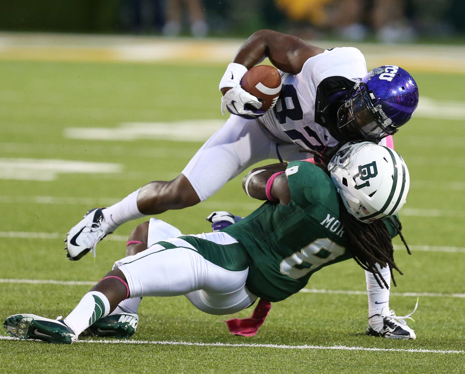Photo -   TCU wide receiver Josh Boyce (82) is brought down by Baylor safety K.J. Morton (8) in the first half of a NCAA college football game, Saturday, Oct 13, 2012, in Waco, Texas. (AP Photo/Waco Tribune Herald, Michael Bancale)