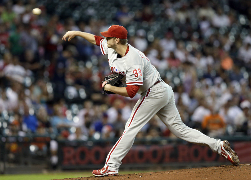 Photo -   Philadelphia Phillies starting pitcher Kyle Kendrick throws during the first inning of a baseball game against the Houston Astros, Saturday, Sept. 15, 2012, in Houston. (AP Photo/David J. Phillip)
