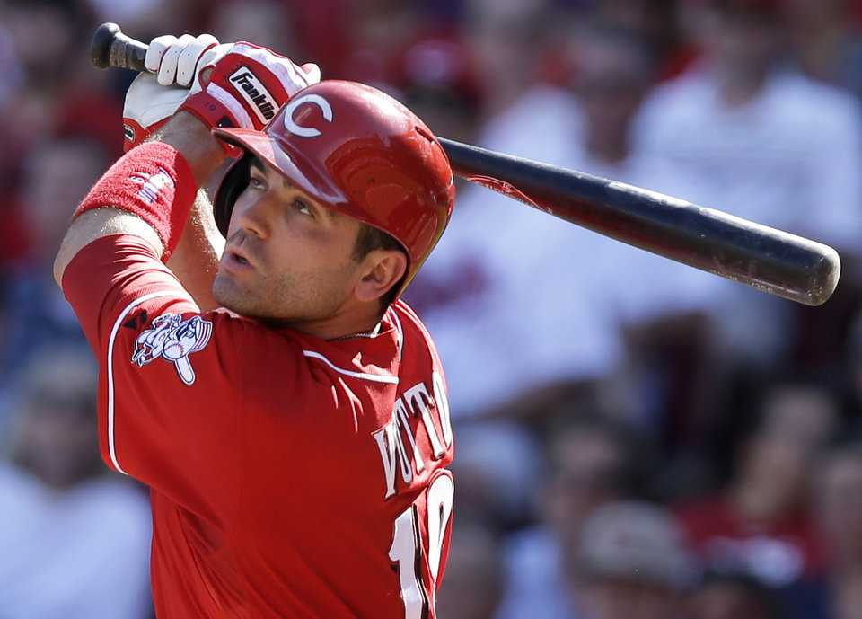 Photo - Cincinnati Reds' Joey Votto hits a double off Toronto Blue Jays starting pitcher J.A. Happ to drive in a run in the fourth inning of a baseball game on Saturday, June 21, 2014, in Cincinnati. (AP Photo/Al Behrman)