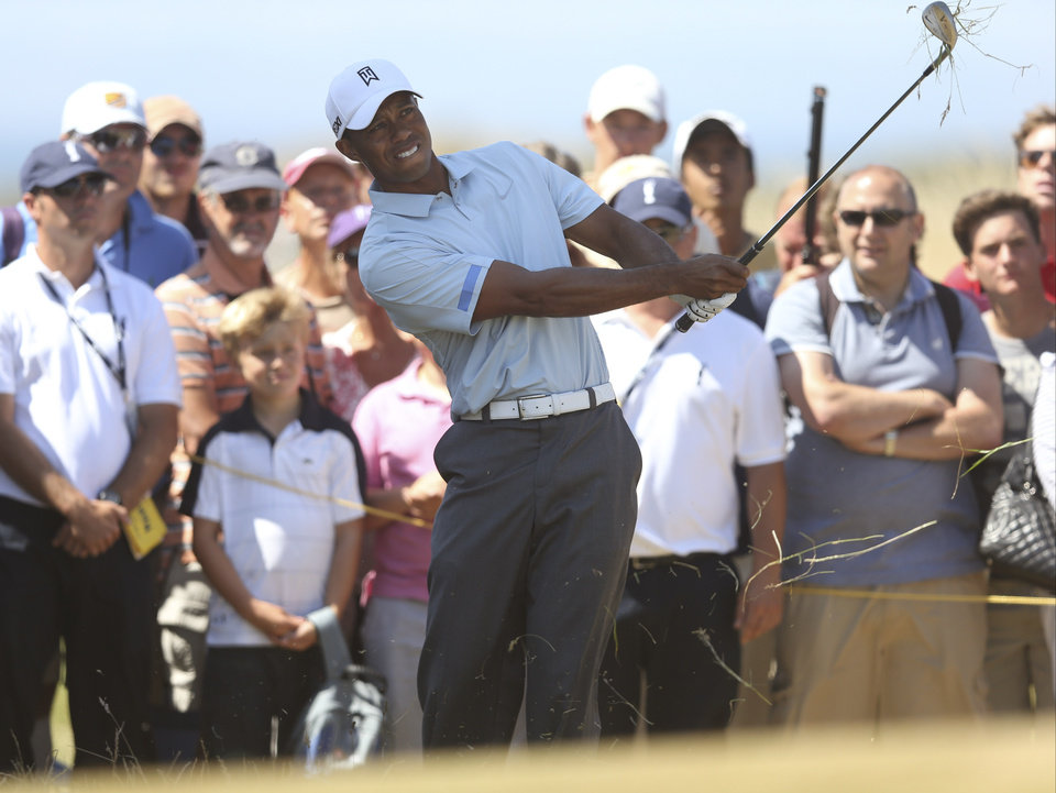 Tiger Woods of the United States plays a shot off the 14th tee during the second round of the British Open Golf Championship at Muirfield, Scotland, Friday July 19, 2013. (AP Photo/Scott Heppell)