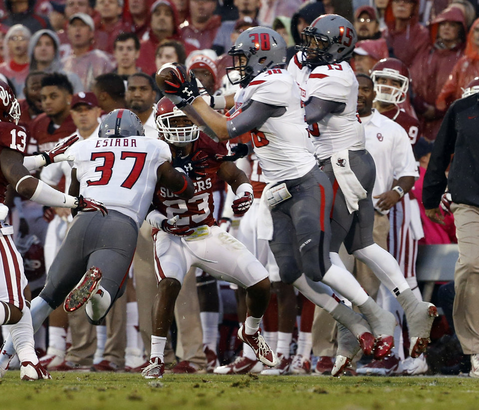 Texas Tech's Summitt Hogue (38) recovers an onside kick in front of Oklahoma's Kass Everett (23) during a college football game where  the University of Oklahoma Sooners (OU) defeated the Texas Tech Red Raiders 38-30 at Gaylord Family-Oklahoma Memorial Stadium in Norman, Okla., on Saturday, Oct. 26, 2013. Photo by Steve Sisney, The Oklahoman