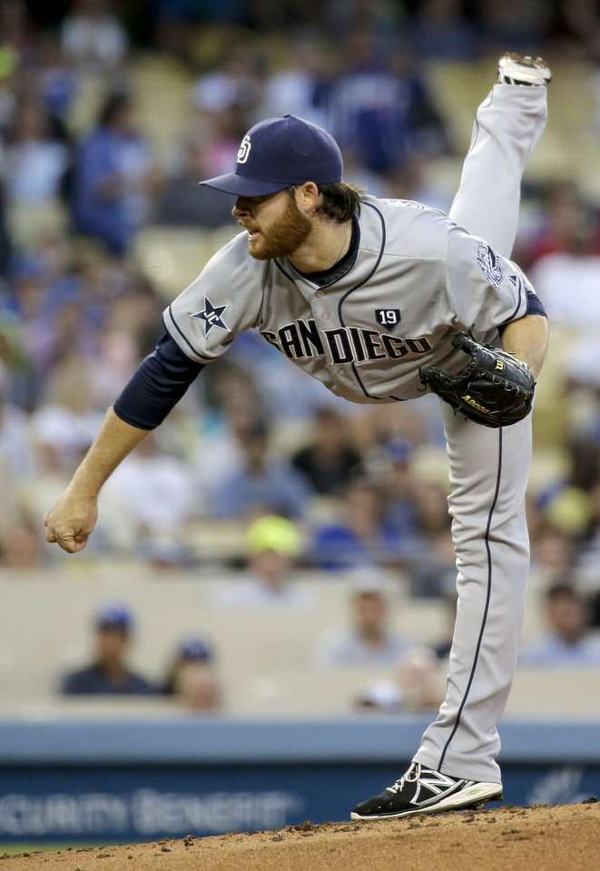 Photo - San Diego Padres starting pitcher Ian Kennedy throws to the Los Angeles Dodgers during first inning of a baseball game in Los Angeles, Tuesday, Aug. 19, 2014. (AP Photo/Chris Carlson)