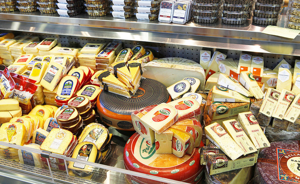 Photo - Uptown Grocery Co. in Edmond offers a wide variety of cheeses. Photo by David McDaniel, The Oklahoman