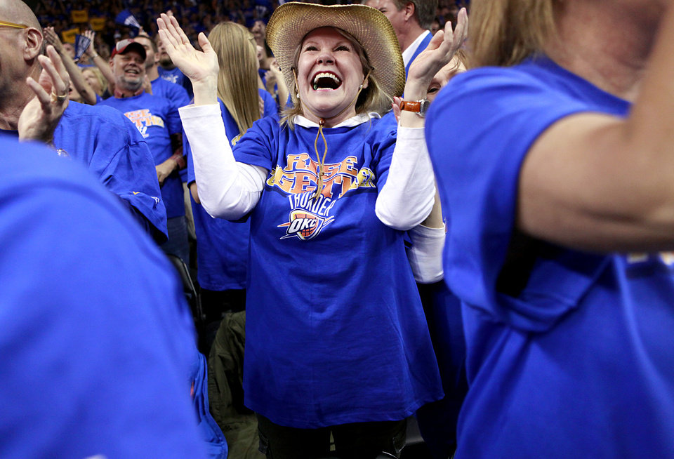 Photo - Sabrina Smythe, of Oklahoma City, cheers for the Thunder during the first half of game 7 of the NBA basketball Western Conference semifinals between the Memphis Grizzlies and the Oklahoma City Thunder at the OKC Arena in Oklahoma City, Sunday, May 15, 2011. Photo by John Clanton, The Oklahoman