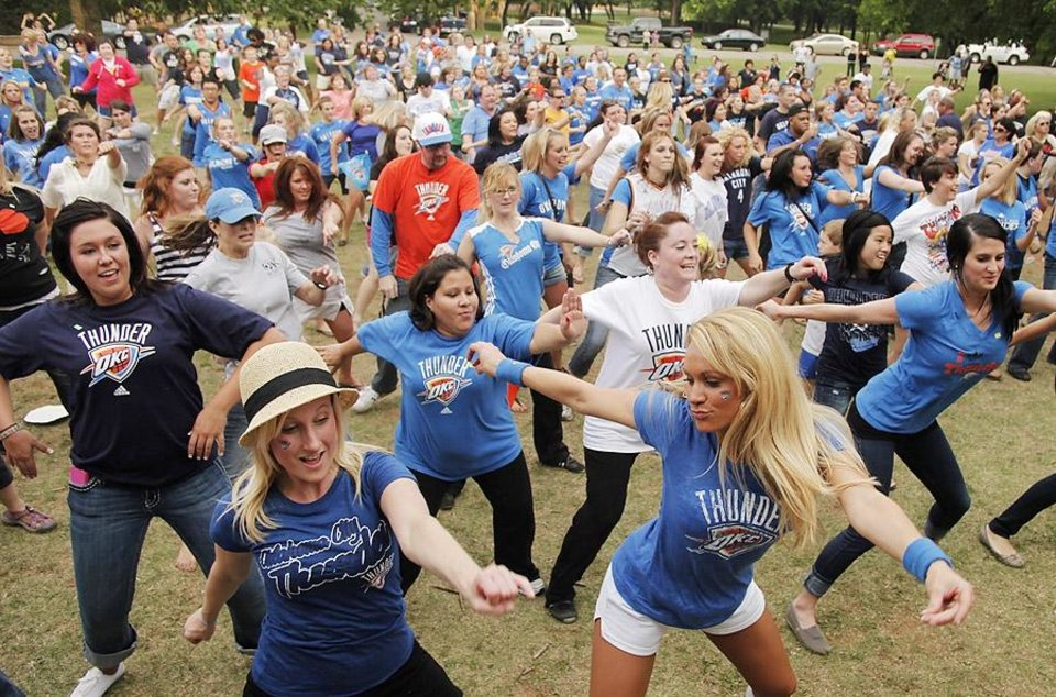 Photo -  The crowd practices the dance steps during a Thunder mob dance to send to Ellen DeGeneres at Hafer Park in Edmond Wednesday, May 18, 2011. Photo by Doug Hoke, The Oklahoman. ORG XMIT: KOD
